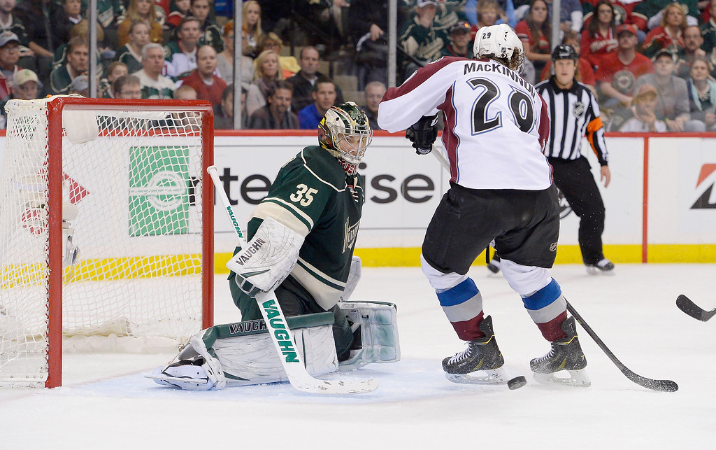 . Colorado Avalanche center Nathan MacKinnon (29) tries to deflect a shot on Minnesota Wild goalie Darcy Kuemper (35) during the second period April 21, 2014 during round 1 game three of the Stanley Cup Playoffs at Xcel Energy Center. (Photo by John Leyba/The Denver Post)