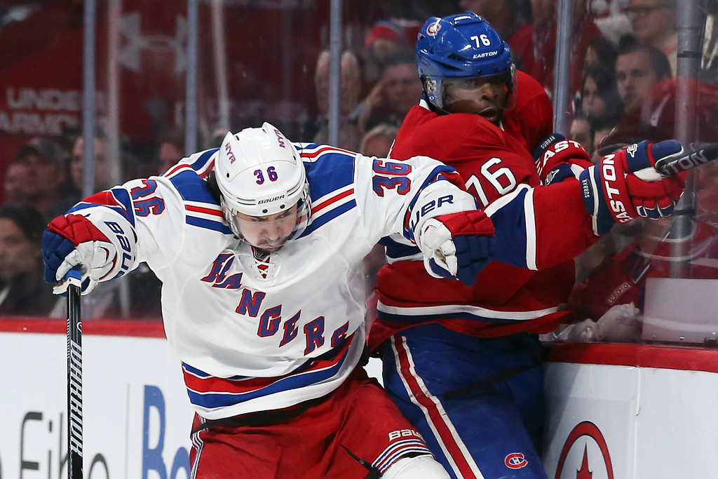 . Mats Zuccarello #36 of the New York Rangers checks P.K. Subban #76 of the Montreal Canadiens during Game Two of the Eastern Conference Final during the 2014 Stanley Cup Playoffs at Bell Centre on May 19, 2014 in Montreal, Canada.  (Photo by Bruce Bennett/Getty Images)
