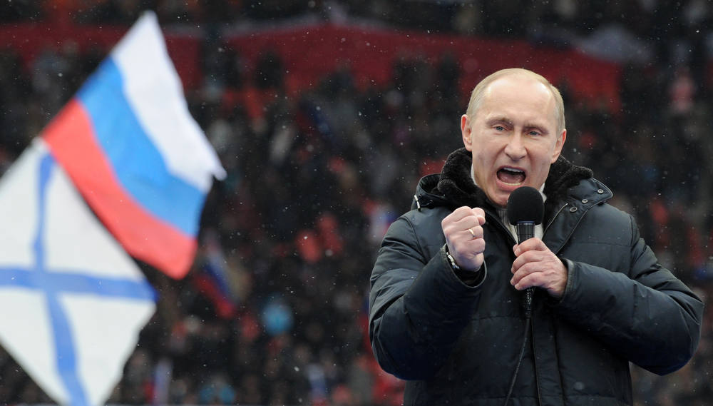 Description of . Russian Presidential candidate, Prime Minister Vladimir Putin delivers a speech during a rally of his supporters at the Luzhniki stadium in Moscow on February 23, 2012. Prime Minister Vladimir Putin on Thursday vowed he would not allow foreign powers to interfere in Russia's internal affairs and predicted victory in an ongoing battle for its future.