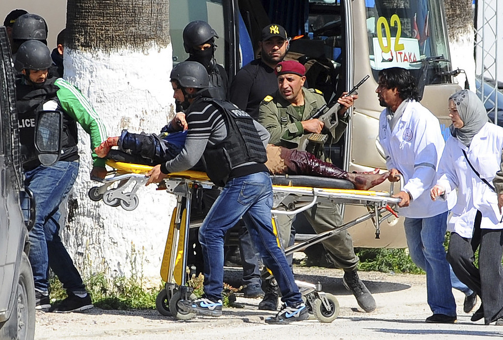 . A victim is being evacuated by rescue workers outside the Bardo museum in Tunis, Wednesday, March 18, 2015 in Tunis, Tunisia. Gunmen opened fire at a leading museum in Tunisia\'s capital, killing 19 people  including 17 tourists, the Tunisian Prime Minister said. A later raid by security forces left two gunmen and one security officer dead but ended the standoff, Tunisian authorities said. (AP Photo/Hassene Dridi)