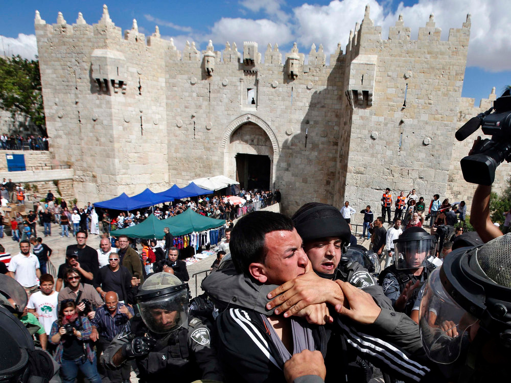 . A Palestinian man is taken away by Israeli border policemen during clashes near Damascus Gate at Jerusalem\'s old city May 15, 2013. Palestinians clashed with Israeli forces in the occupied West Bank and at East Jerusalem on Wednesday during demonstrations to mark 65 years since what they call the Nakba (Catastrophe) when Israel\'s creation caused many to lose their homes and become refugees. REUTERS/Baz Ratner