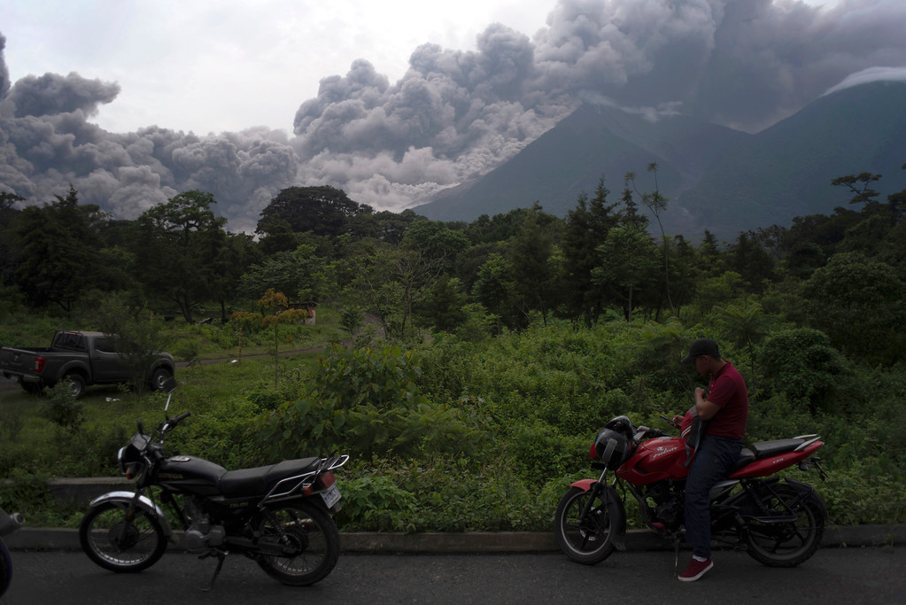 . Volcan de Fuego, or Volcano of Fire, blows outs a thick cloud of ash, as seen from Alotenango, Guatemala, Sunday, June 3, 2018. One of Central America\'s most active volcanos erupted in fiery explosions of ash and molten rock Sunday, killing people and injuring many others while a towering cloud of smoke blanketed nearby villages in heavy ash. (AP Photo/Santiago Billy)
