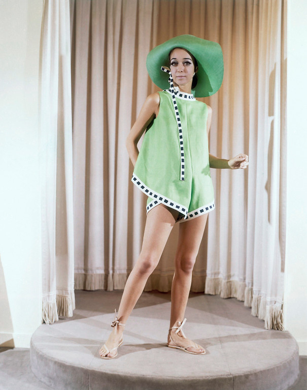 . Paris couturier Pieorre Belmain presented this green linen beach ensemble in his spring and summer collection showings in Paris in 1969. It is edged with navy and white corps worn with a large green hat. (AP Photo)