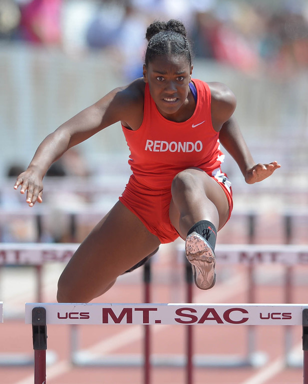 . Redondo\'s Kristen Hamlin competes in the 100 meter Division 2 high hurdles race of the CIF Southern Section Track and Field Championships Saturday at Mt. SAC. 20130518 Photo by Steve McCrank / Staff Photographer