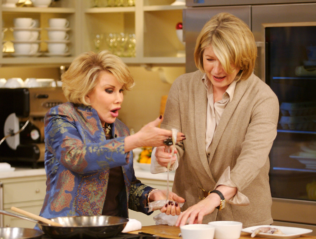 . In this handout photo released by The Martha Stewart Show, Joan Rivers, left, and Martha Stewart prepare   stuffed calamari on Wednesday Dec. 19, 2007 in New York. (AP Photo/The Martha Stewart Show, Anders Krusberg)