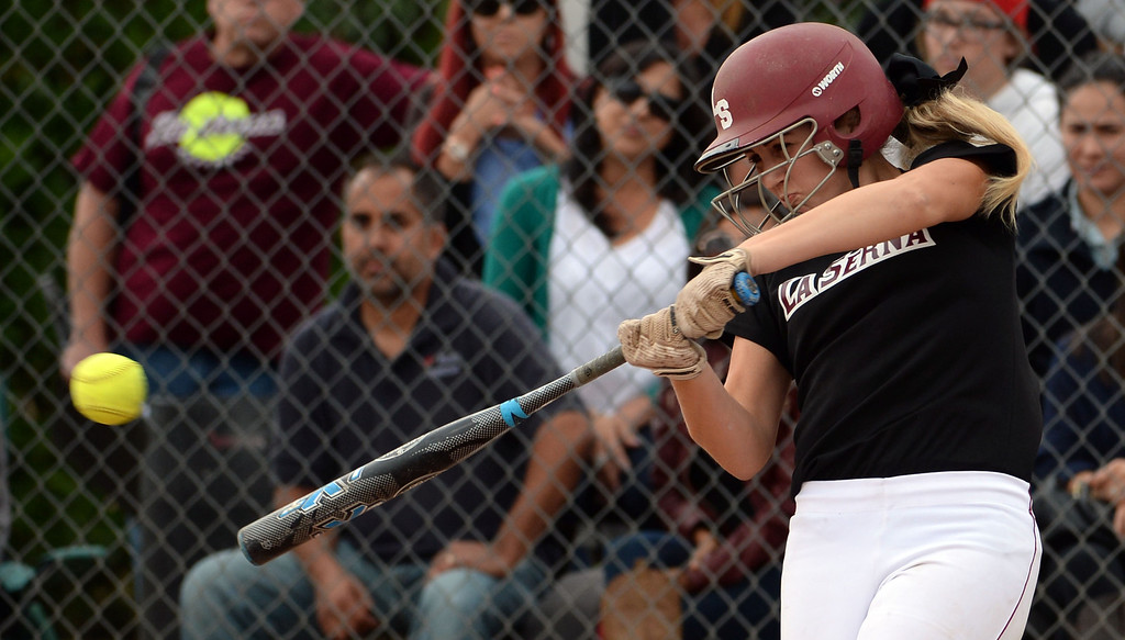 . La Serna\'s Molly Bourne singles in the second inning of a prep playoff softball game against Bishop Amat at Bishop Amat High School in La Puente, Calif., on Thursday, May 22, 2014. La Serna won 6-0.   (Keith Birmingham/Pasadena Star-News)
