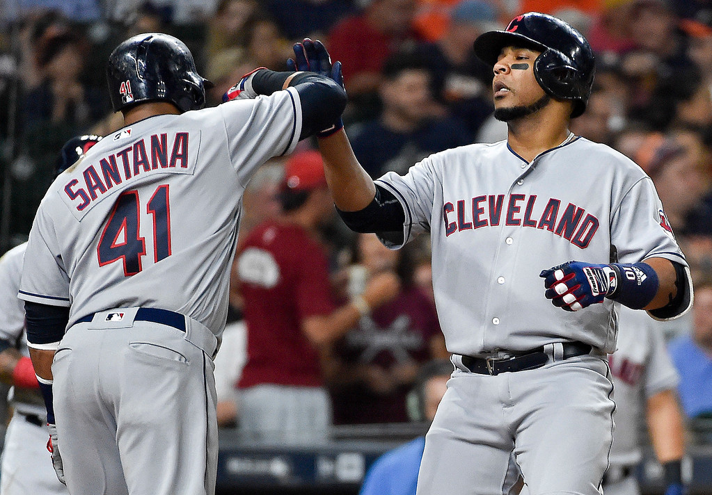 . Cleveland Indians designated hitter Edwin Encarnacion celebrates his two-run home run off Houston Astros starting pitcher Charlie Morton with teammate Carlos Santana (41) during the fourth inning of a baseball game, Friday, May 19, 2017, in Houston. (AP Photo/Eric Christian Smith)