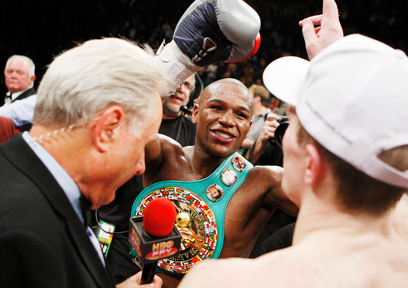 . Floyd Mayweather Jr. center shakes hands with Ricky Hatton, right, of Great Britain, following their WBC welterweight boxing title fight at the MGM Grand hotel-casino in Las Vegas, Saturday, Dec. 8, 2007. (AP Photo/Isaac Brekken)