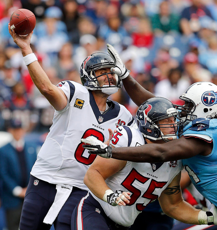 . Houston Texans quarterback Matt Schaub (8) gets a pass away as center Chris Myers (55) blocks Tennessee Titans defensive tackle Sen\'Derrick Marks, right, in the first quarter of an NFL football game on Sunday, Dec. 2, 2012, in Nashville, Tenn. (AP Photo/Joe Howell)