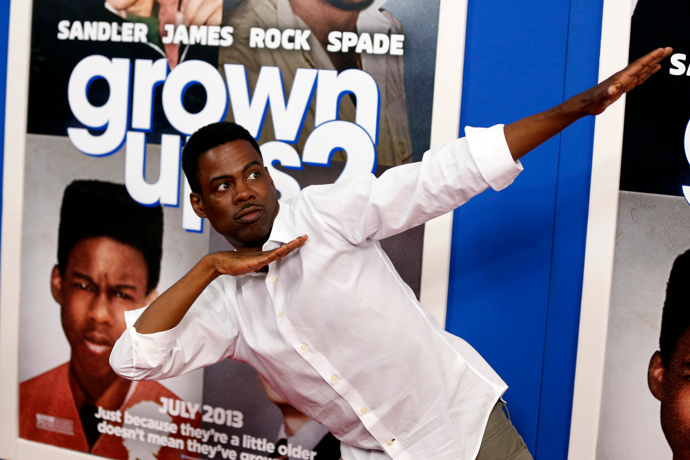 ". Cast member Chris Rock gestures as he arrives for the premiere of the film ""Grown Ups 2\"" in New York, July 10, 2013. REUTERS/Lucas Jackson"