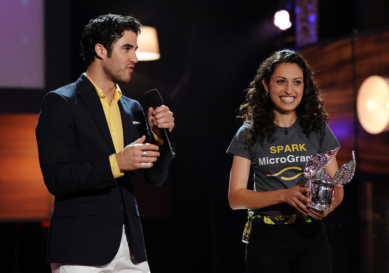 . Actor Darren Criss presents award to Sasha Fisher of SPARK MicroGrants onstage at the DoSomething.org and VH1\'s 2013 Do Something Awards at Avalon on July 31, 2013 in Hollywood, California.  (Photo by Kevin Winter/Getty Images)