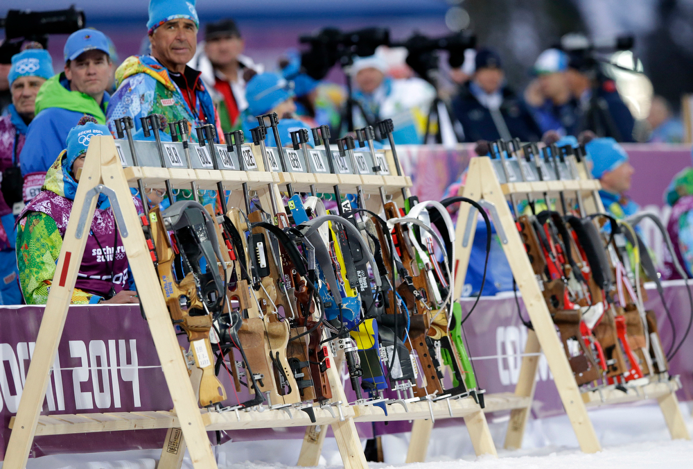 . Rifles are lined up in the shooting range during the men\'s biathlon 4x7.5K relay at the 2014 Winter Olympics, Saturday, Feb. 22, 2014, in Krasnaya Polyana, Russia. (AP Photo/Lee Jin-man)