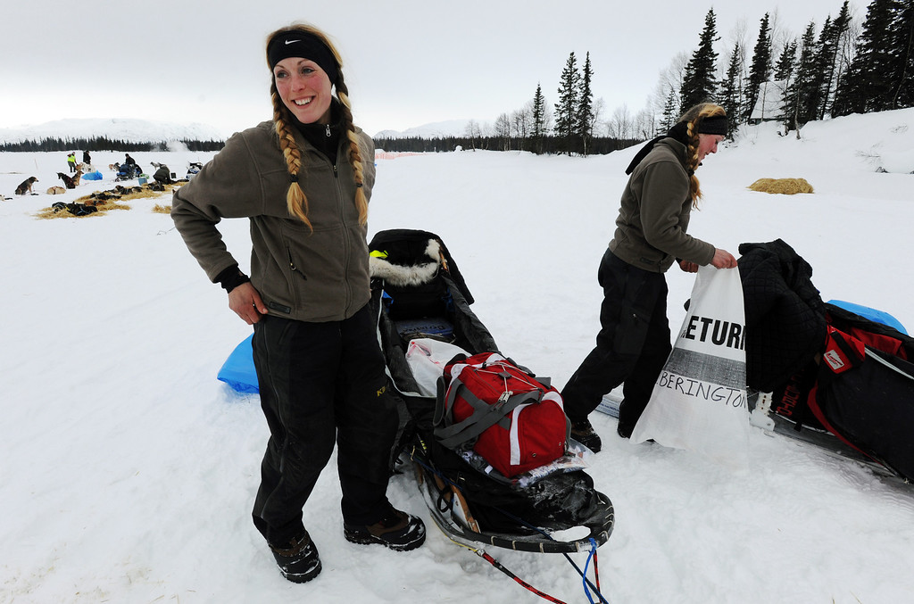 . Kristy Berington, left, and twin sister Anna Berington, right, pack up their sleds as they prepare to leave the Finger Lake checkpoint in Alaska during the Iditarod Trail Sled Dog Race on Monday, March 4, 2013. (AP Photo/The Anchorage Daily News, Bill Roth)