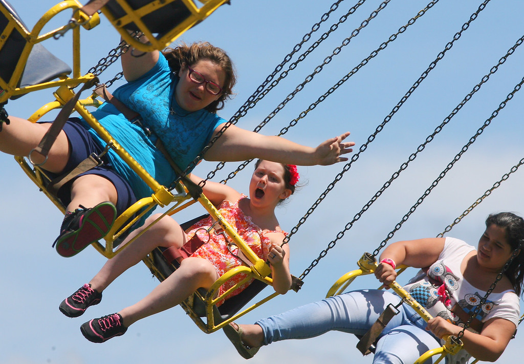 . fair goers ride on the Yo Yo on the midway at the Boonville Oneida County Fair on Thursday, July 24, 2014 in Boonville. The fair runs through Sunday, July 27, 2014. JOHN HAEGER-ONEIDA DAILY DISPATCH @ONEIDAPHOTO ON TWITTER