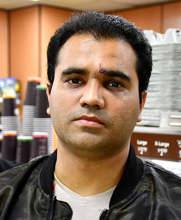 10/31/2019 Mike Orazzi | StaffrMustafa Sajjad talks about being robbed by a man wielding a knife at the 7-Eleven on Riverside Avenue in Bristol. r