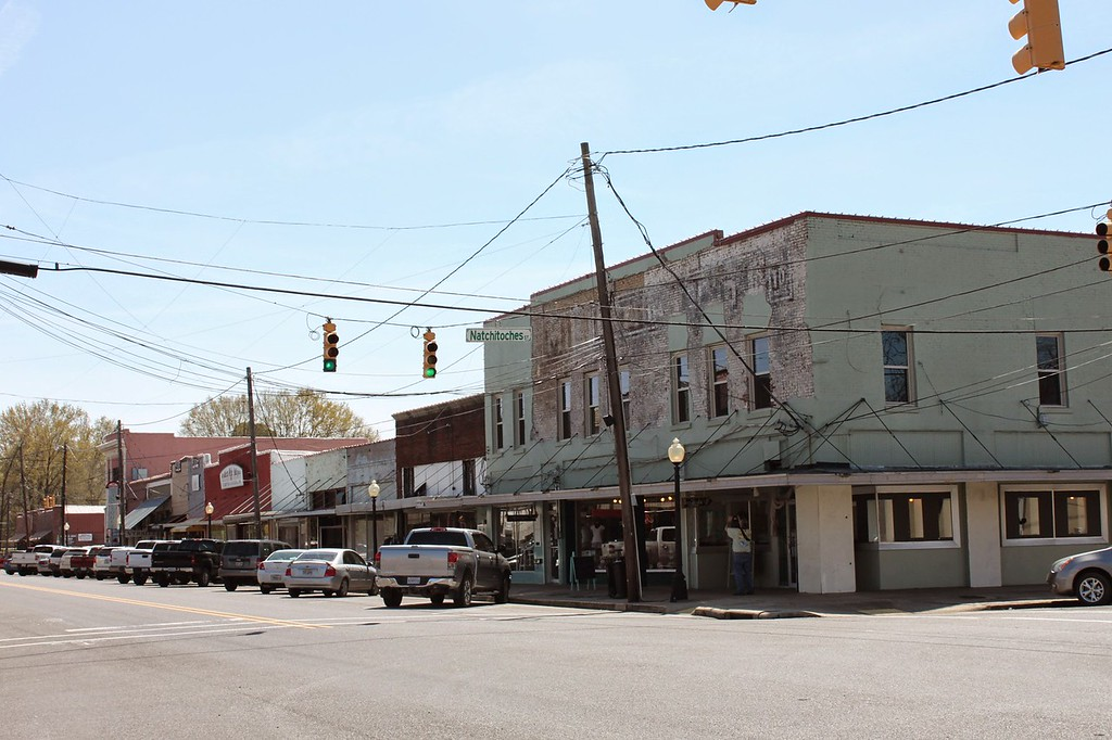 A row of faded buildings in Monroe now operate as antique stores
