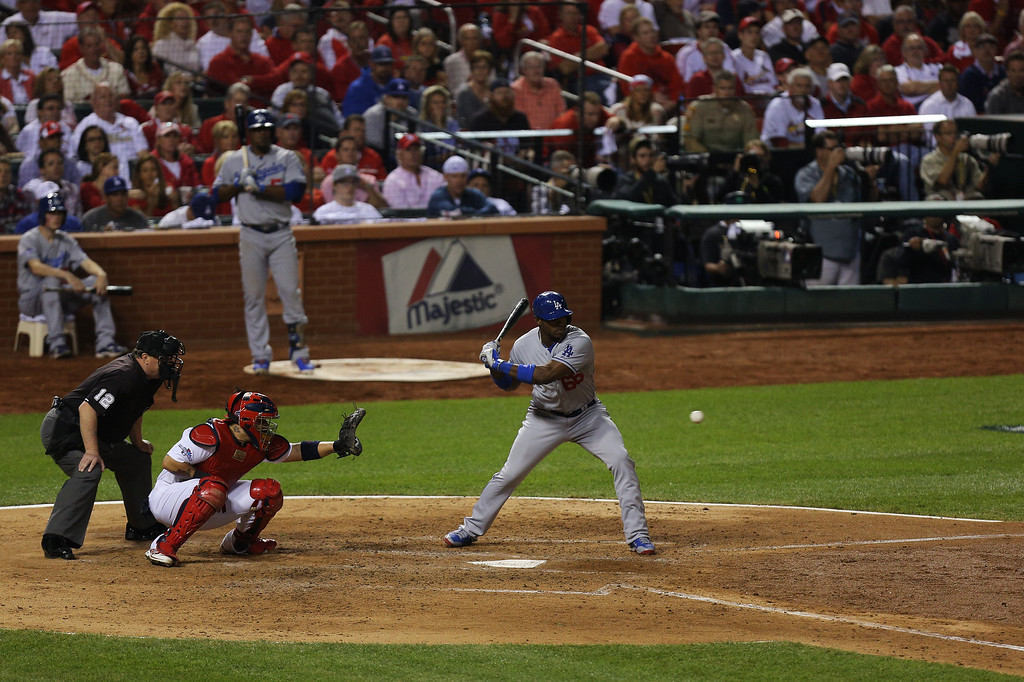 . ST LOUIS, MO - OCTOBER 11:  Yasiel Puig #66 of the Los Angeles Dodgers bats against the St. Louis Cardinals in the third inning during Game One of the National League Championship Series at Busch Stadium on October 11, 2013 in St Louis, Missouri.  (Photo by Ed Zurga/Getty Images)