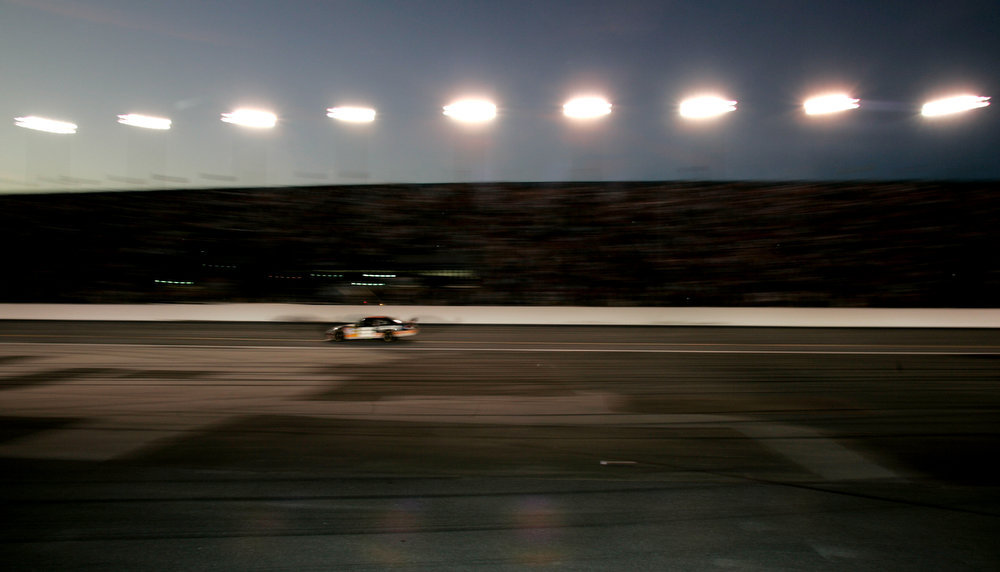 . Cars race through the tri-oval during the 50th running of the Daytona 500 auto race at Daytona International Speedway in Daytona Beach, Fla., Sunday, Feb. 17, 2008. (AP Photo/Ryan Matay)