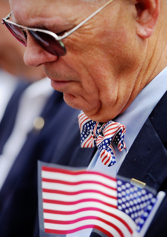 """. Lynchburg City Council member Hunsdon \'H.\"""" Cary lowers his head for the invocation preceding the National Anthem at the Memorial Day service at Monument Terrace Monday, May 27, 2013 in Lynchburg, Va.   (AP Photo/News & Daily Advance, Sam O\'Keefe)"""