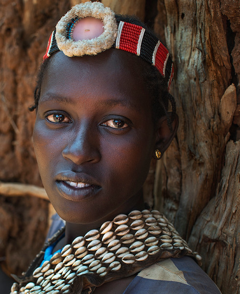 Banna, Bana, and Benna are other spellings for the Bena people. They are neighbors with the Hamer tribe and it is believed that the Bena actually originated from them centuries ago. The market in Key Afer is often visited by them.  Just like most of the indigenous tribes in the lower Omo Valley, the Bena practice ritual dancing and singing. The men often have their hair dressed up with a colorful clay cap that is decorated with feathers. Both the men and women wear long garments and paint their bodies with white chalk. Women of the tribe wear beads in their hair that is held together with butter.  The Bena look very similar to the Hamer and are often called the Hamer-Bena. Common rituals and traditions of other tribes are shared by the Bena. The boys in the tribe participate in bull jumping. When it is time for the boy to become a man, he must jump over a number of bulls naked without falling. If he is able to complete this task, he will become a man and be able to marry a woman.  Omo Valley, Ethiopia, 2017
