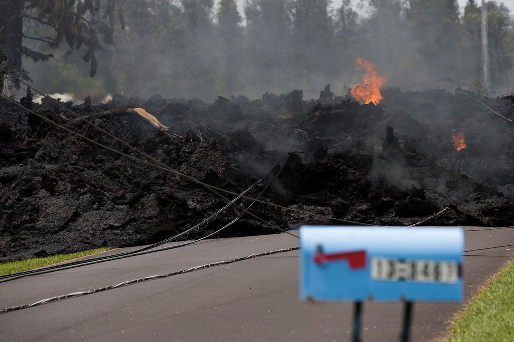. A mail box stands near the lava flow in the Leilani Estates, Saturday, May 5, 2018, in Pahoa, Hawaii. The Hawaiian Volcanoes Observatory said eight volcanic vents opened in the Big Island residential neighborhood of Leilani Estates since Thursday. The Leilani Estates area is at the greatest risk for more lava outbreaks. (AP Photo/Marco Garcia)