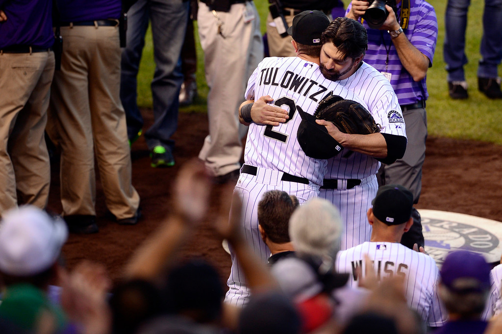 . Todd Helton hugs Troy Tulowitzki before the start of action in Denver. The Colorado Rockies hosted the Boston Red Sox and said farewell to longtime first baseman Todd Helton, who recently announced his retirement following this season. (Photo by AAron Ontiveroz/The Denver Post)