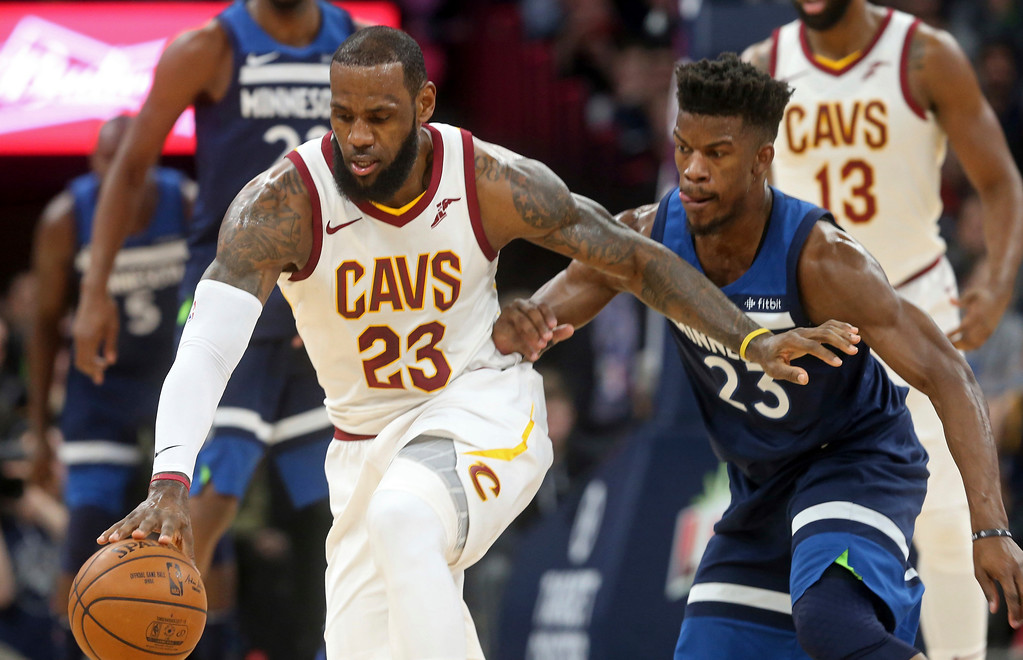 . Cleveland Cavaliers\' LeBron James, left, and Minnesota Timberwolves\' Jimmy Butler chase the ball in the first half of an NBA basketball game Monday, Jan. 8, 2018, in Minneapolis. (AP Photo/Jim Mone)