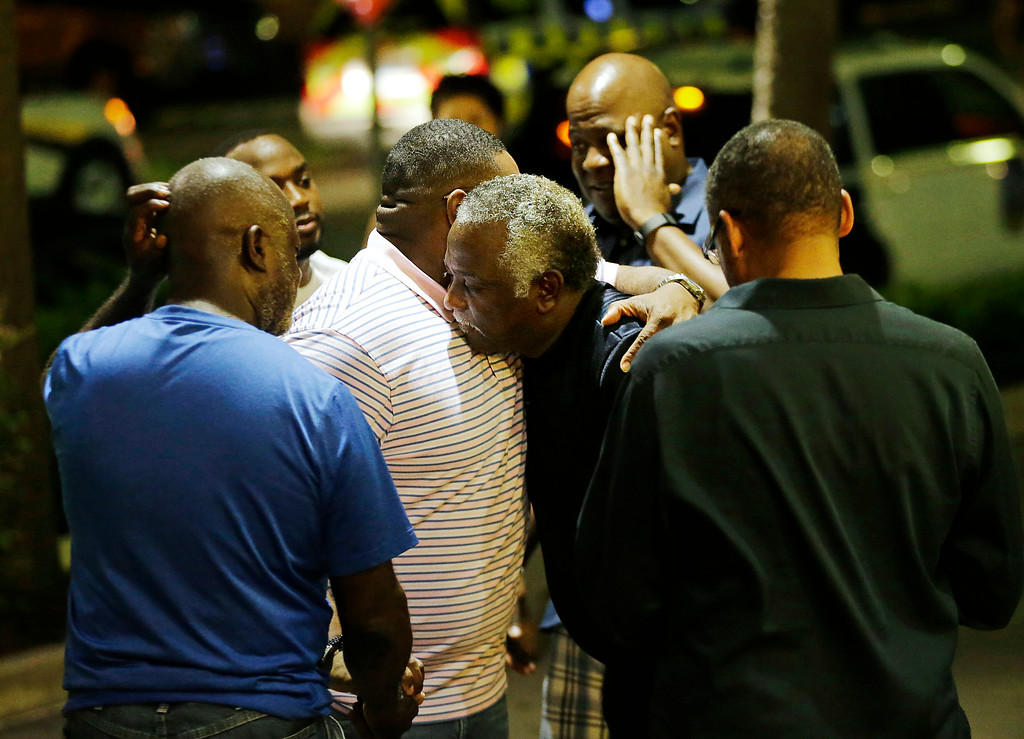 . Worshippers embrace following a group prayer across the street from the Emanuel AME Church following a shooting Wednesday, June 17, 2015, in Charleston, S.C. (AP Photo/David Goldman)