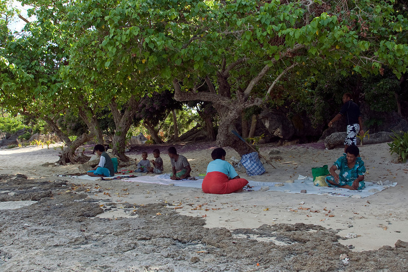 Locals resting on the beach - Yasawa Islands, Fiji