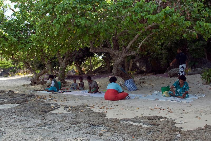 Locals resting on the beach - Yasawa Islands, Fiji
