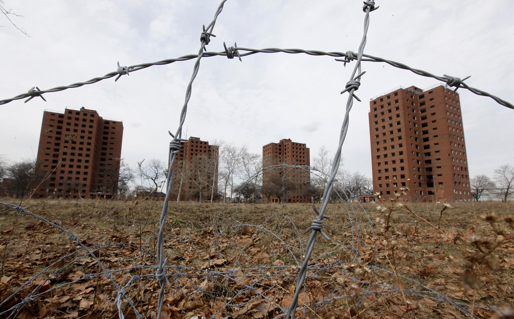 """. Part of the Brewster-Douglass housing project site is shown in Detroit, Friday, March 18, 2011.  If Detroit Housing Commission director Eugene Jones  had his way the \""""for sale\"""" sign he\'d post off Interstates 75 and 375 would read: \""""14 acres of prime real estate between the city\'s resurgent downtown and promising Midtown. A steal at $9 million. Will accept reasonable offer.\"""" Real offers have been few. One arts group proposal to hang junked cars from windows in one the Brewster-Douglass housing project\'s empty 14-story towers was declined. Unlike cities like Chicago, where the last building in notorious Cabrini-Green public housing complex was razed within months of the final family moving out, Brewster-Douglass has been empty for two years and none of the 20 brick buildings has been torn down. Neither the city nor Jones\' commission has the money to demolish the complex which is beginning to rival the long-empty, 17-story Michigan Central Depot as another symbol of Detroit\'s decay. (AP Photo/Paul Sancya)"""