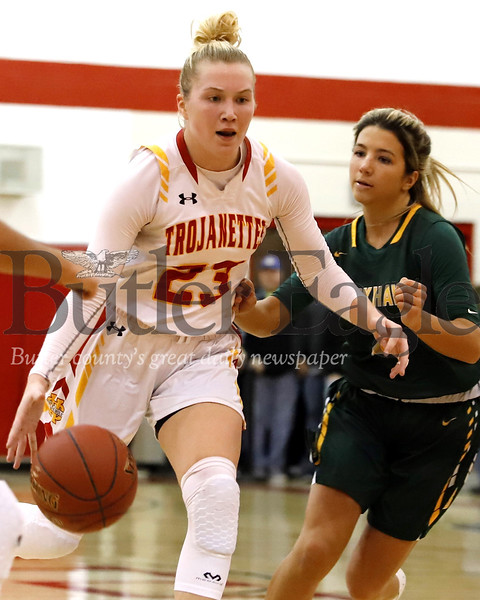 North Catholic's Tess Myers drives the lane against Blackhawk's Jillian Mannarino (4) in Monday night's WPIAL Playoff. Seb Foltz/Butler Eagle