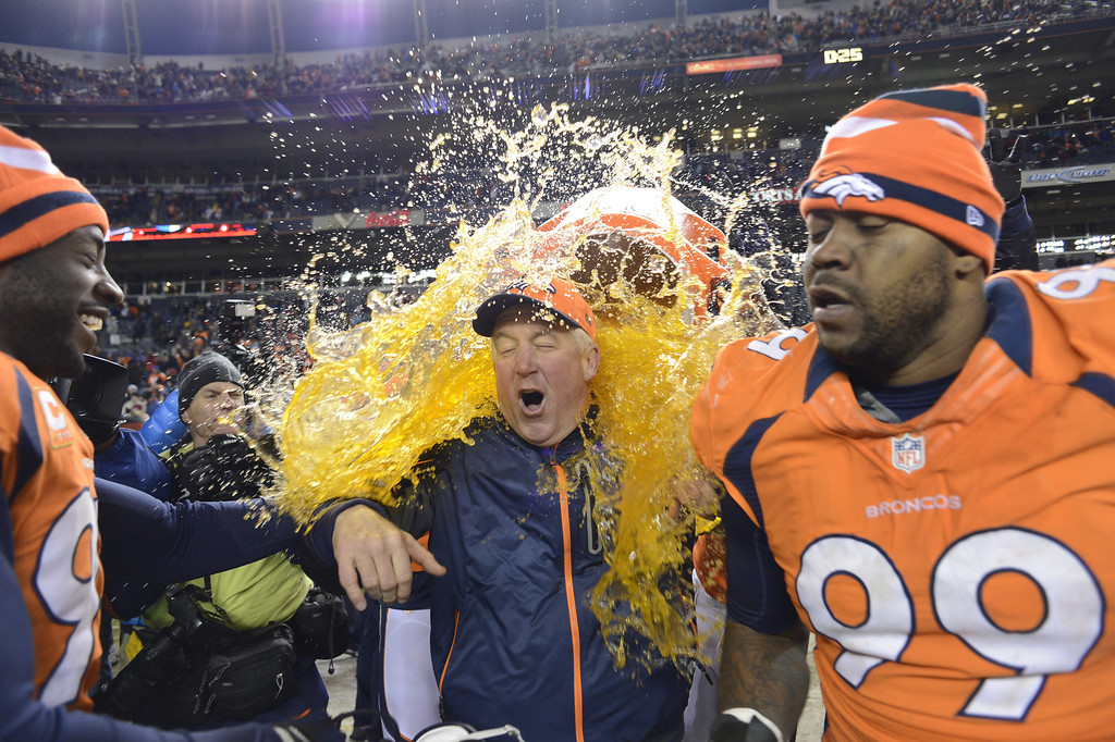. Denver Broncos head coach John Fox gets doused at the end of the game as the Denver Broncos took on the Kansas City Chiefs at Sports Authority Field at Mile High in Denver, Colorado on December 30, 2012. John Leyba, The Denver Post