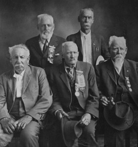 """This undated photograph from the Spearfish Area Historical Society is believed to show """"The Last Civil War Veterans of Spearfish - The War of 1861.""""  With the able assistance of Dorothy Honadel, we've identified these gentleman as follows:   standing (left-to-right) are Wilson Williams and William Crist.  Seated are Thomas McEveny, Giles Fish, and James Manwaring."""