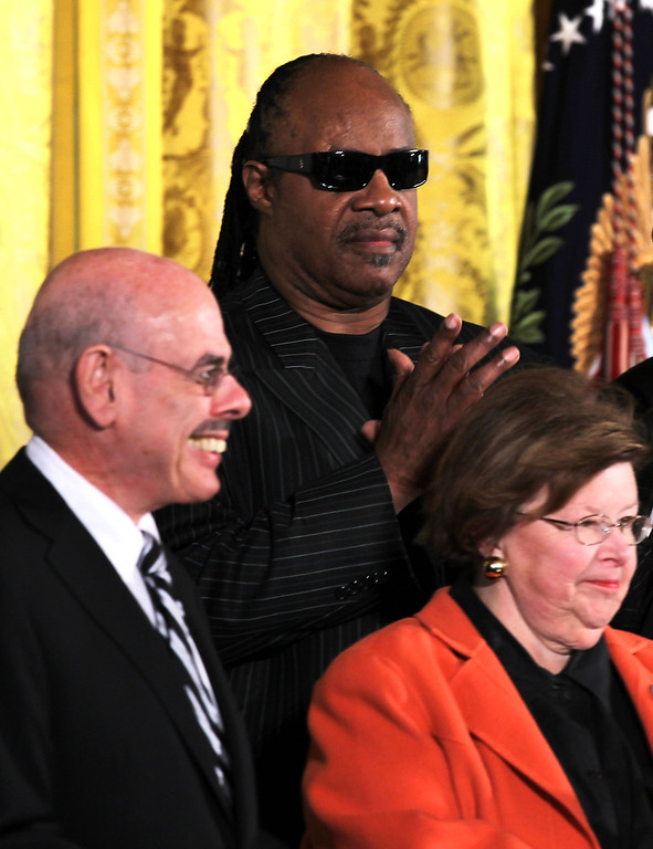 . Singer Stevie Wonder (C), Sen. Barbara Mikulski (D-MD) (R), and Rep. Henry Waxman (D-CA) attend an East Room event October 8, 2010 at the White House in Washington, DC. U.S. President Barack Obama signed the Twenty-First Century Communications and Video Accessibility Act of 2010 into law during the event.  (Photo by Alex Wong/Getty Images)