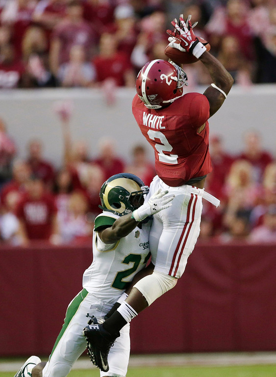 . Alabama wide receiver DeAndrew White (2) catches a pass as Colorado State defensive back Bernard Blake (23) covers during the first half of an NCAA college football game in Tuscaloosa, Ala., Saturday, Sept. 21, 2013. (AP Photo/Dave Martin)