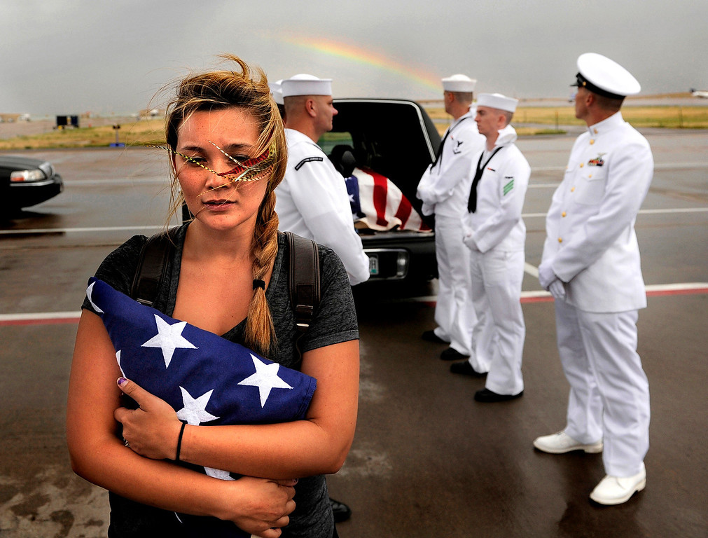 . Chantel Blunk, wife of Jonathan Blunk, waits Friday, July 27, 2012, on the tarmac at Denver International Airport as her husbands body is about to be loaded into a plane to fly to Reno Nevada for his full military funeral. Blunk a five-year U.S. Navy veteran that was killed during a July 20 shooting rampage at a movie theater in Aurora. RJ Sangosti, The Denver Post