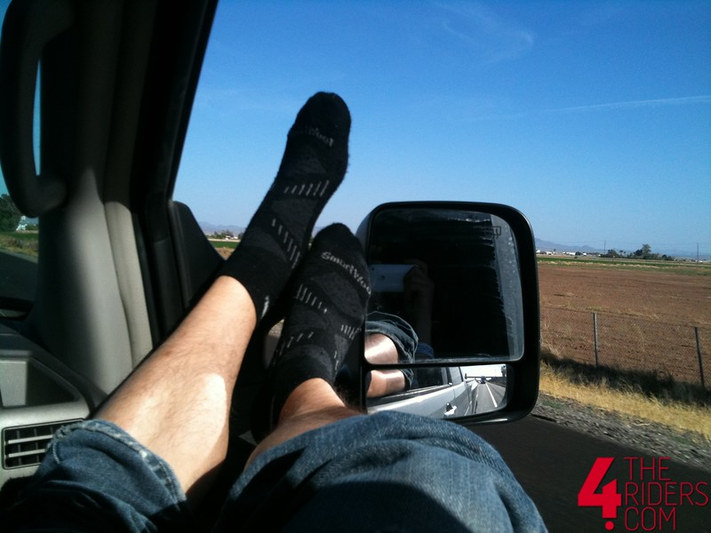 matt's feet dangle out the window
