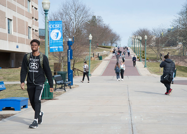 03/11/20 Wesley Bunnell | StaffrrCCSU is joining the growing number of schools which will be going to online classes for the remainder of the semester due to Coronavirus fears. Students walk near the student union on Wednesday Feb 11, 2020.
