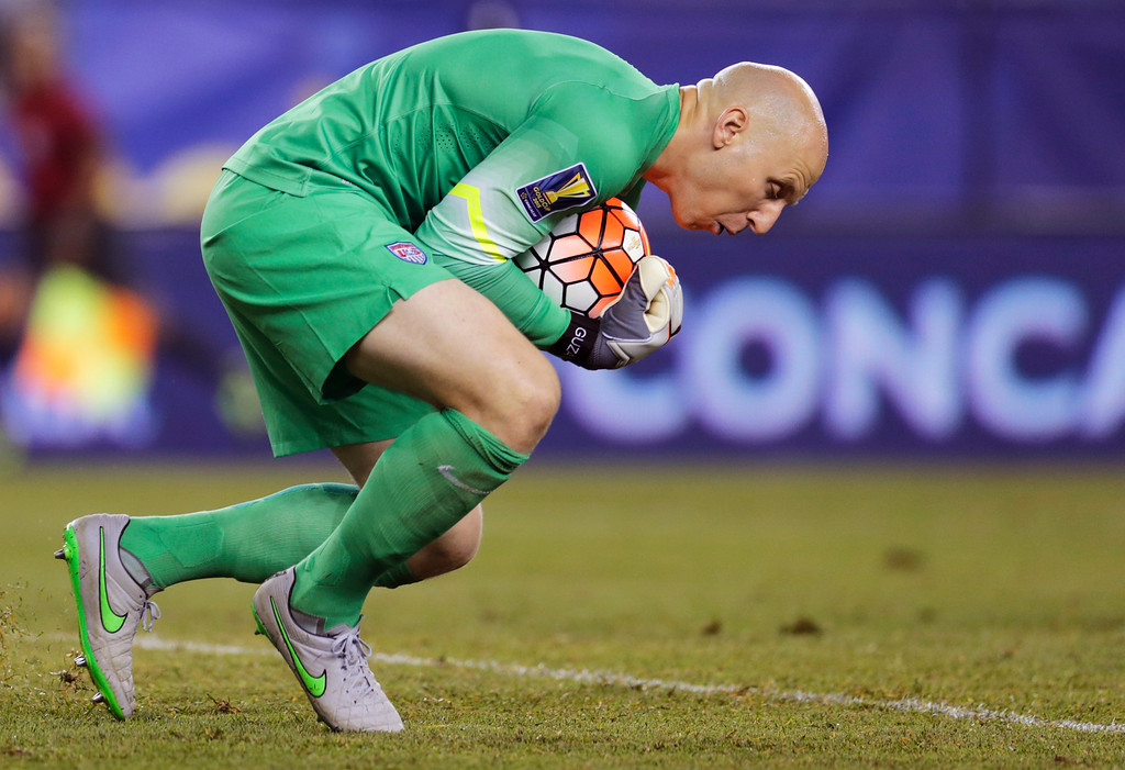 . In this July 10, 2015, file photo, U.S. goalie Brad Guzan makes a save against Haiti during the second half of a CONCACAF Gold Cup soccer match in Foxborough, Mass. Tim Howard or Brad Guzan will play for the United States in next month\'s World Cup qualifiers against Guatemala despite losing their starting jobs in England\'s Premier League. (AP Photo/Charles Krupa, File)