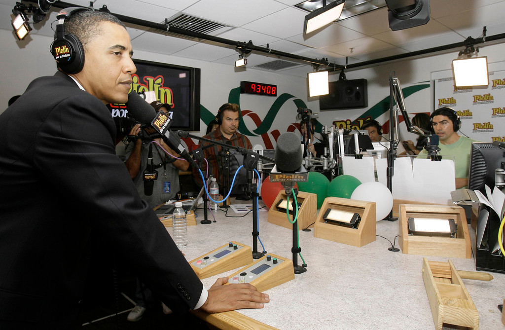". Presidential hopeful Sen. Barack Obama, D-Ill., listens during an interview, Thursday, Aug. 9, 2007, with talkshow host Eddie ""Piolin\"" Sotelo, background right, during his nationally syndicated radio show \""Piolin por la Manana,\"" in Glendale, Calif. (AP Photo/Nick Ut)"