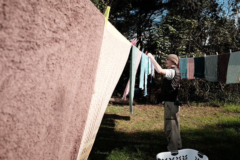 Man Hanging out the Washing