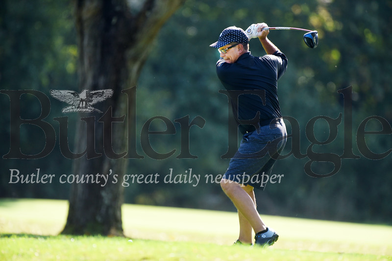 Harold Aughton/Butler Eagle: Tom Poljak of the Tom & Tom Golf Show on ESPN, prepares to launch his drive during the Butler County Pro Am Fall Golf Classic held at the Butler Country Club, Wed., Oct. 2.