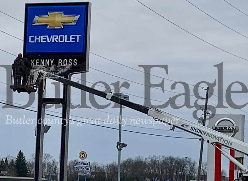 Photos by Alexandria Mansfield.Crews replace Kenny Ross signs with #1 Cochran after the company acquired its Chevrolet and Nissan locations in Zelienople.