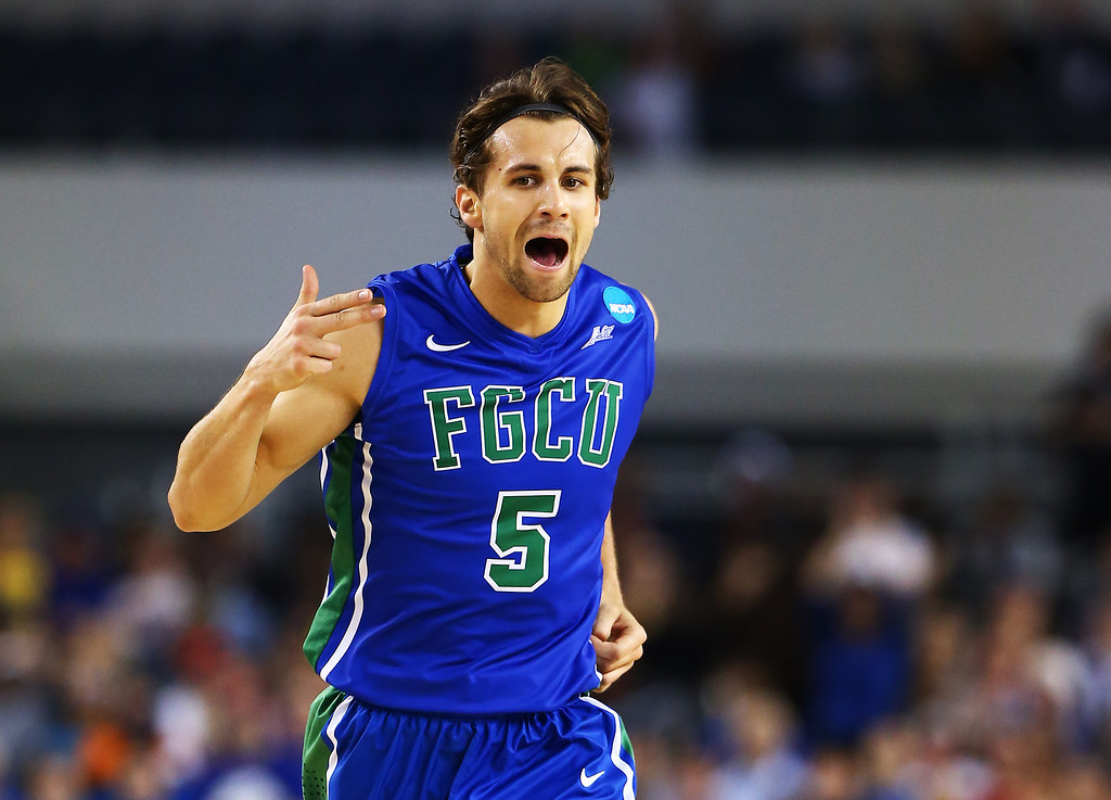 . ARLINGTON, TX - MARCH 29:  Christophe Varidel #5 of the Florida Gulf Coast Eagles celebrates in the first half against the Florida Gators during the South Regional Semifinal round of the 2013 NCAA Men\'s Basketball Tournament at Dallas Cowboys Stadium on March 29, 2013 in Arlington, Texas.  (Photo by Tom Pennington/Getty Images)