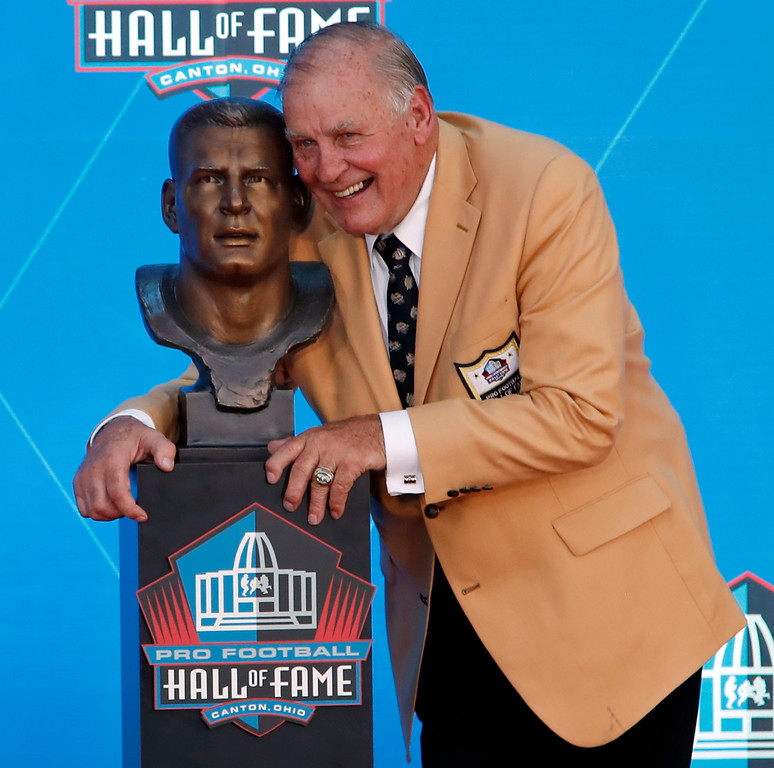 . Former NFL player Jerry Kramer poses with a bust of himself during inductions at the Pro Football Hall of Fame, Saturday, Aug. 4, 2018 in Canton, Ohio. (AP Photo/Gene J. Puskar)