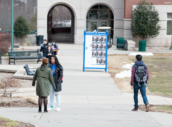 03/22/18 Wesley Bunnell | Staff CCSU students walk around campus on March 22.
