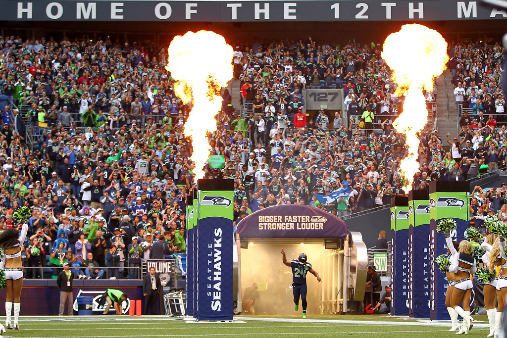 . Marshawn Lynch #24 of the Seattle Seahawks runs on the field prior to the game against the San Francisco 49ers at Qwest Field on September 15, 2013 in Seattle, Washington.  (Photo by Jonathan Ferrey/Getty Images)