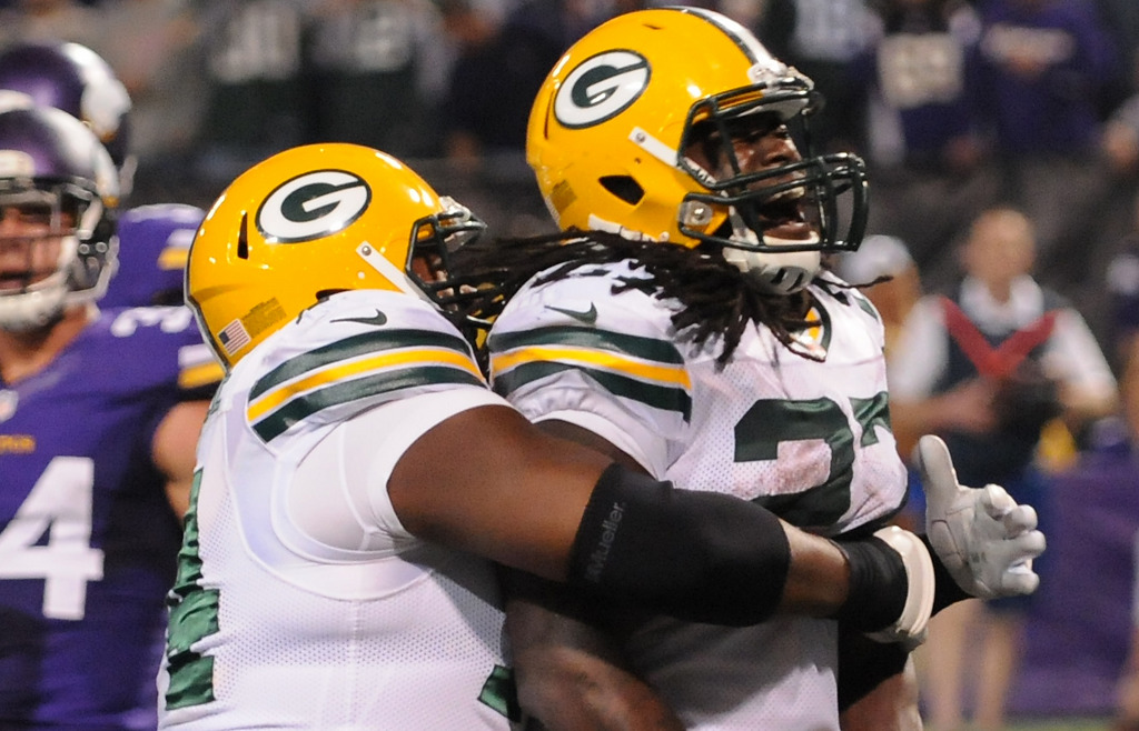 . Green Bay running back Eddie Lacy is hugged by tackle Marshall Newhouse after rushing for a touchdown in the third quarter. (Pioneer Press: John Autey)