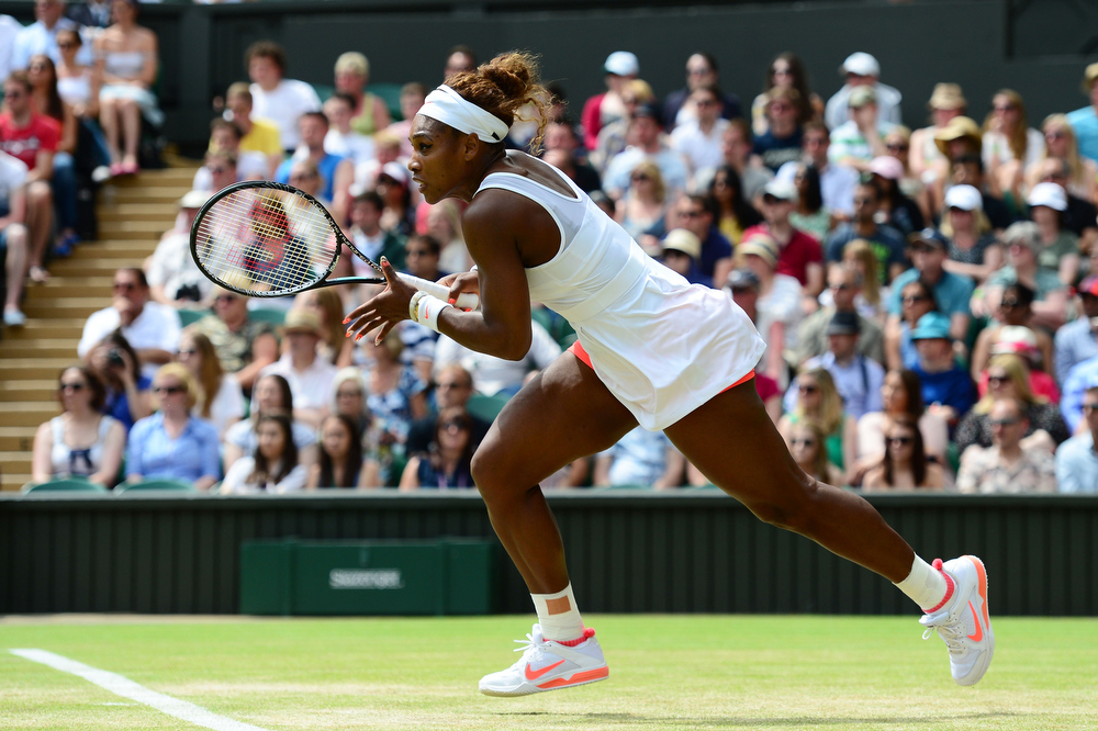 . Serena Williams of United States of America in action during her Ladies\' Singles fourth round match against Sabine Lisicki of Germany on day seven of the Wimbledon Lawn Tennis Championships at the All England Lawn Tennis and Croquet Club on July 1, 2013 in London, England.  (Photo by Mike Hewitt/Getty Images)
